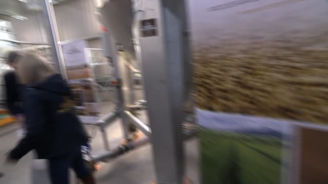 jo swinson visits crafty maltsters in fife scotland fife auchtermuchty int jo swinson and willie rennie along / swinson's necklack / swinson and... - dipping stock videos & royalty-free footage