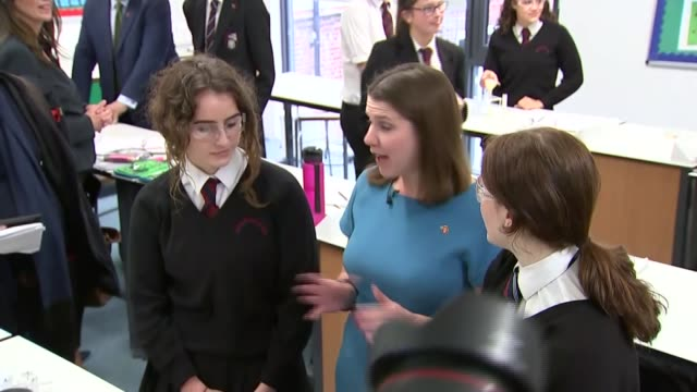 jo swinson visits esher high school england surrey esher hinchley wood school photography** jo swinson chatting with year 9 students in classroom... - the earth: a film lesson in general science stock videos & royalty-free footage