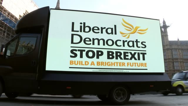 labour party campaign launch / donald trump intervention england london westminster ext various of liberal democrats mobile election hoarding poster... - british liberal democratic party stock videos & royalty-free footage