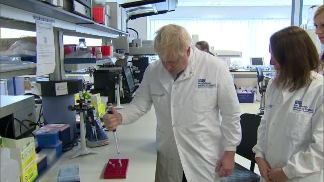 labour party campaign launch / donald trump intervention england cambridge addenbrooke's hospital nhs genomic laboratory hub int boris johnson mp... - preparation stock videos & royalty-free footage