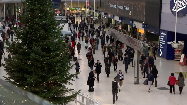labour pledges to cut rail fares by a third england london waterloo station gv commuters getting off train ext gv platform and commuters along int... - strike industrial action stock videos & royalty-free footage