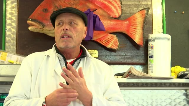 martel's markets view from romford england london romford ext various of stalls in market vox pops sot people along in market fish being sold on... - toffee stock-videos und b-roll-filmmaterial