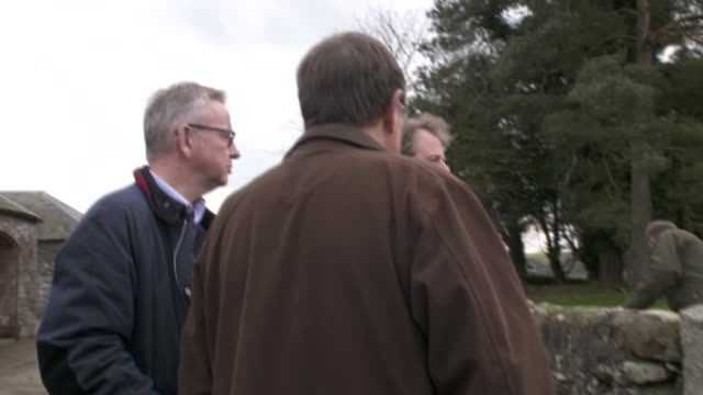 michael gove visits farm in scottish borders scotland dumfries and galloway ext michael gove chatting with farmers and alister jack in farm yard and... - feeding stock videos & royalty-free footage