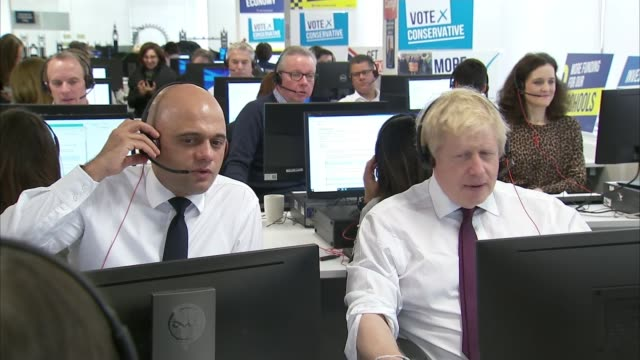 parties make further pledges with three days of campaigning remaining england london conservative party hq int various of boris johnson and sajid... - sajid javid stock videos & royalty-free footage