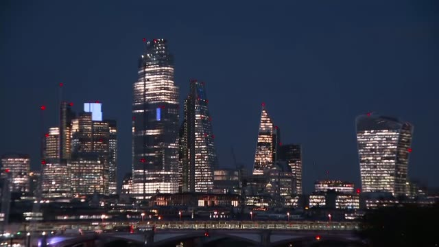 sajid javid and john mcdonnell set out rival spending plans england london city of london skyscrapers of the city of london with lights illuminated... - office block exterior stock videos & royalty-free footage