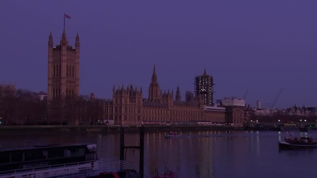 sunrise over houses of parliament england london lambeth ext / dawn houses of parliament and westminster palace seen across river thames as sky... - sunrise dawn stock videos & royalty-free footage