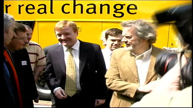 Liberal Democrats ITN ENGLAND Hampshire Portsmouth EXT / Liberal Democrats battle bus along road / Charles Kennedy MP out of bus greeted / Kennedy on...
