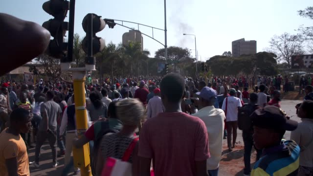 armed police clash with opposition protesters in harare zimbabwe harare ext various of opposition supporters taking part in street protests / 'ed has... - zimbabwe stock videos & royalty-free footage