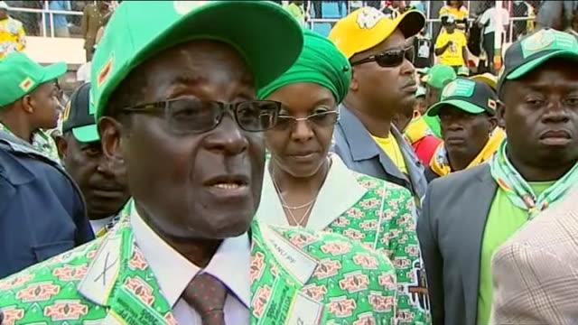 general election build-up: robert mugabe interview; zimbabwe: harare: national sports stadium: ext various shots of robert mugabe waving to cheering... - political rally stock videos & royalty-free footage