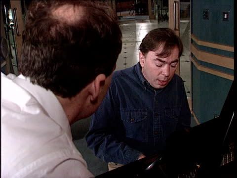 campaign media managers england tms andrew lloyd webber and cons party director of communications shaun woodward by piano working on theme tune for... - andrew lloyd webber stock videos and b-roll footage
