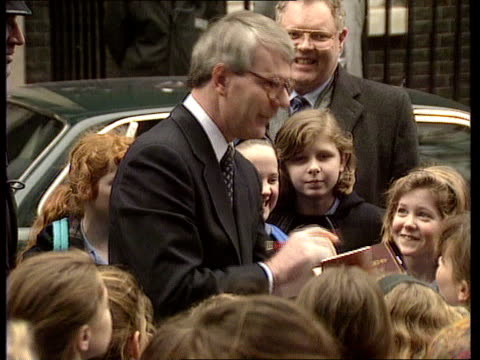 campaign media managers ext london downing st john major mp signing autographs for schoolchilden - autogramm stock-videos und b-roll-filmmaterial