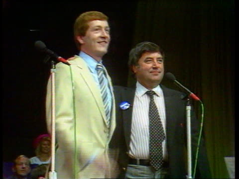 celebrities tx wembley conference centre tbv crowd and banner at tory party rally cms steve davis and jimmy tarbuck standing at mics tbv audience... - kenny everett stock videos & royalty-free footage