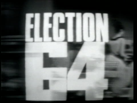 computer wizardry; 1964 - general election england: london: itn studio opening titles itn election programme 1964 sof as alastair burnet takes seat &... - alastair burnet stock videos & royalty-free footage
