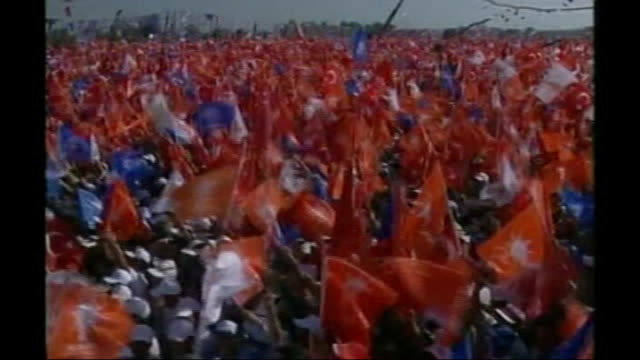 constitutional crisis; turkey: istanbul: ext * * turkish music overlaid on the following shots sot * * crowds waving turkish flag at political rally... - recep tayyip erdoğan stock videos & royalty-free footage