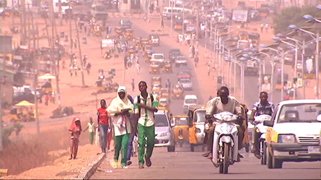 corruption debate vox pops sot people and traffic along road various of people living in shacks next to railway line location unknown various of... - nigeria stock videos and b-roll footage