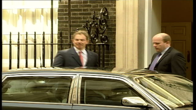Motorcade to Buckingham Palace ITN ENGLAND London Downing Street EXT Tony Blair MP out of No 10 into car car away