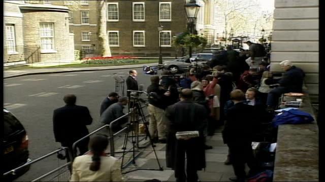 Motorcade to Buckingham Palace ITN ENGLAND London Downing Street Cars along Tony Blair out of car into No 10