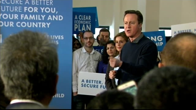 vídeos de stock, filmes e b-roll de david cameron urges labour to rule out pact with snp england london harrow int audience members holding placards placards including 'strong... - stop placa em inglês