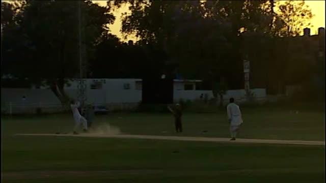 vídeos y material grabado en eventos de stock de final campaigning pakistan islamabad general views of group of men playing cricket day man holding up cricket bat with slogan 'i love imran khan' at... - bate de críquet