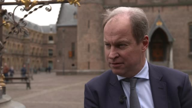 geert wilders poised to make gains the hague reporter along with hofvijver lake and binnenhof in background swan along lake with binnenhof building... - binnenhof stock videos and b-roll footage