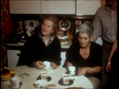 housing 1980 then pm margaret thatcher drinks tea in kitchen of council home buying family pan lr rest of family - margaret thatcher stock videos & royalty-free footage