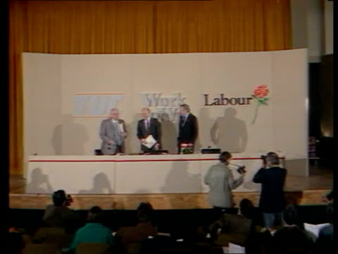 general election: labour economic proposals; b) england: london: millbank: int norman willis , neil kinnock and roy hattersley onto platform and pose... - labour party stock videos & royalty-free footage