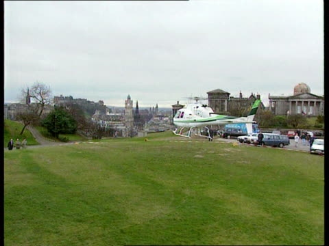 stockvideo's en b-roll-footage met labour policy for scotland c4n scotland edinburgh gv city as helicopter coming into land ext g/air helicopter carrying shadow home sec roy hattersley... - roy hattersley