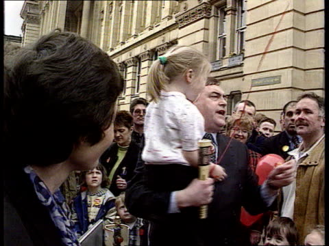general election montage; itn unspecified location: ext labour deputy leader john prescott picks up girl and father takes her off him - politik und regierung stock-videos und b-roll-filmmaterial
