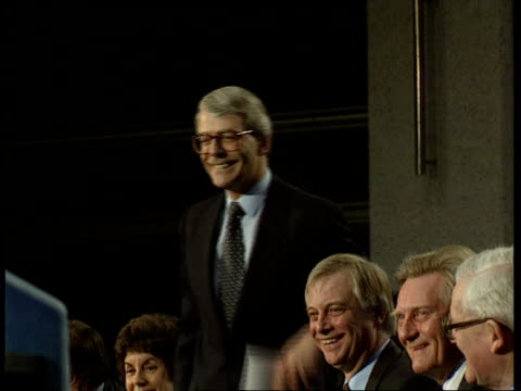 party manifestos history/ impact england london westminster qe2 centre john major at conservative party manifesto launch as holds up manifesto... - john major stock-videos und b-roll-filmmaterial