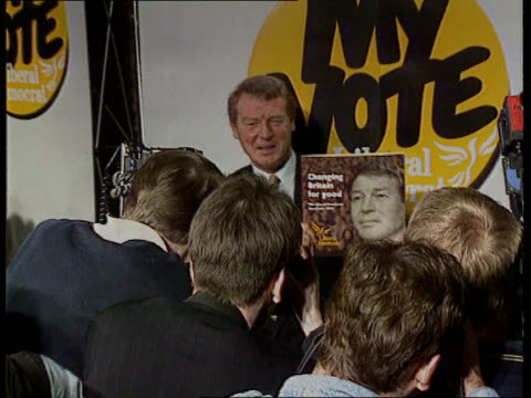 party manifestos history/ impact national liberal club tms lib dem ldr paddy ashdown holds up manifesto for photocall zoom in tx 16392 itn tory... - queen elizabeth hall stock videos and b-roll footage