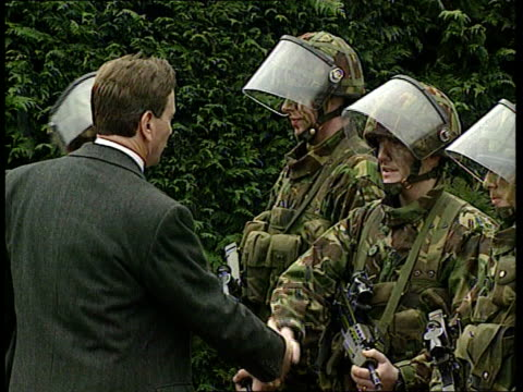 portillo itn n ireland portadown michael portillo mp meeting troops of quick reaction force bv portillo looking at display of weapons - michael portillo stock videos & royalty-free footage