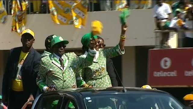 Robert Mugabe interview T28071306 / TX National Sports Stadium EXT Robert Mugabe and wife Grace Mugabe waving to cheering crowds from opentop car at...