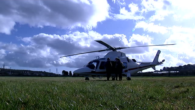 seats of senior liberal democrat mps at risk ext alexander conducting tv interview / camera monitor showing alexander / helicopter parked on grass /... - helicopter rotors stock videos and b-roll footage