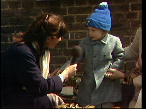 general election special, 'the nation decides'; london: flood street: anna ford interviews with boy who gave thatcher toy bunny - anna ford stock videos & royalty-free footage
