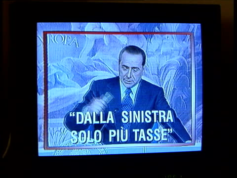 vídeos y material grabado en eventos de stock de vote counting in close contest; sequence television set showing various channels owned by berlusconi and graphicised shots of berlusconi along - concurso television