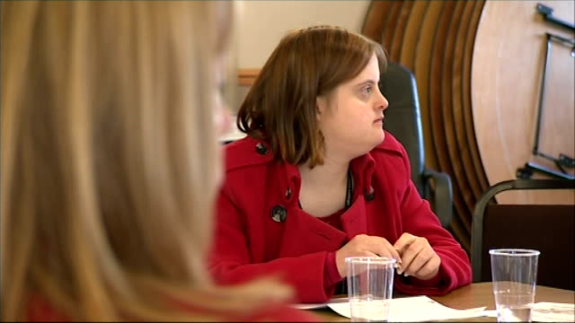 general election; voters with learning disabilities; england: gloucestershire: int various of people with learning difficulties seated at political... - editorial bildbanksvideor och videomaterial från bakom kulisserna
