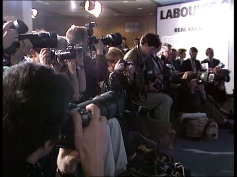 campaign england london tory central office john major followed by tory chairman chris patten and others along corridor pull out pan lr as towards... - john major stock-videos und b-roll-filmmaterial