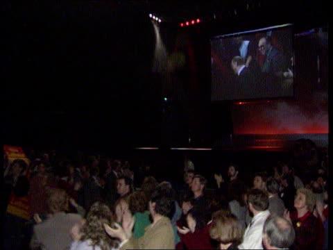 campaign kinnock ***music tlms kinnock and wife glenys along aisle spotlit ms screen and stage with flashing lights la ms kinnock on giant screen... - spokesman stock videos and b-roll footage