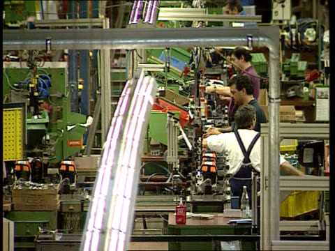 employment german model itn workers assembling power tools in stihl power too plant workers inserting cards into machine to clock off andreas stihl... - changing clock stock videos and b-roll footage