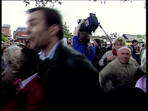 leaders; itn england: surrey labour leader tony blair shaking with people on walkabout and from platform woman telling tory heckler to shut up tory... - british labour party stock videos & royalty-free footage