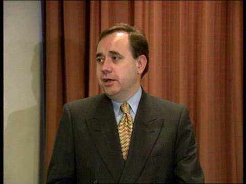 general elections party manifestos scotland leader alex salmond mp at launch of poster alex salmond mp pkf tories trying to put tartan ribbon around... - party poster stock videos & royalty-free footage