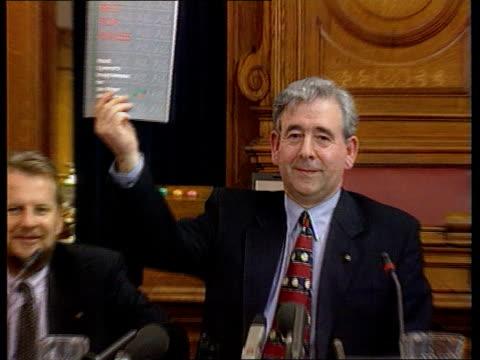 plaid cymru itn wales cardiff cardiff city hall plaid cymru president dafydd wigley holding up copy of his parties manifesto at pkf - plaid stock videos & royalty-free footage