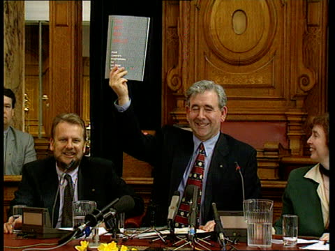 plaid cymru itn wales cardiff cardiff city hall plaid cymru pres dafydd wigley holding up copy of his party's manifesto at pkf cs manifesto held... - plaid stock videos and b-roll footage