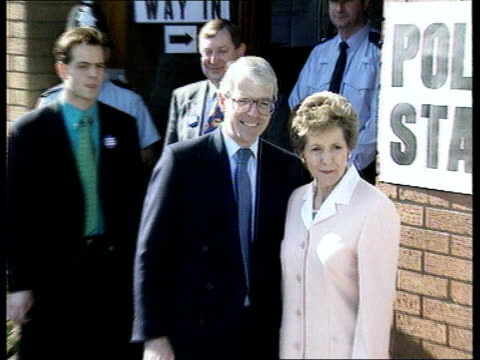 general elections polling day; itn england: somerset: yeovil: lms paddy ashdown and wife jane and dog towards across field cms & ashdown and wife... - itv london tonight stock-videos und b-roll-filmmaterial