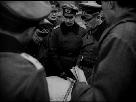 General Erwin Rommel holding baton looking over map w/ Nazi officers Chief of German High Command Nazi Field Marshal Wilhelm Keitel looking at...