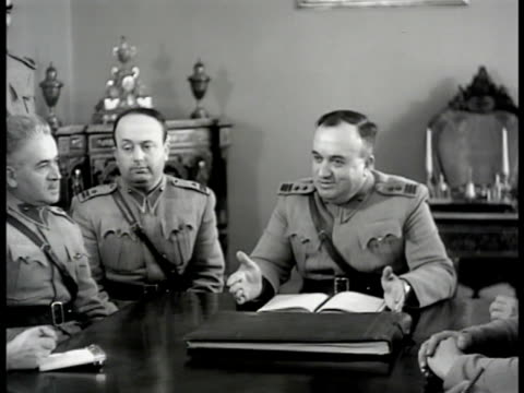 vídeos de stock e filmes b-roll de general feyzi menguch other war officers in meeting around table ms menguch at head of table talking vs officials listening ms members at table - 1947