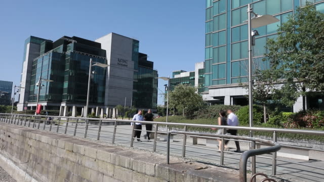 general financial area in dublin including the irish central bank google googles new building commuters ireland on wednesday june 6 2018 - financial building stock videos and b-roll footage