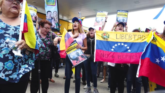 general footage as people show their support for the interim venezuelan president juan guaido during a rally at the venezuelan el original el arepazo... - doral stock videos and b-roll footage