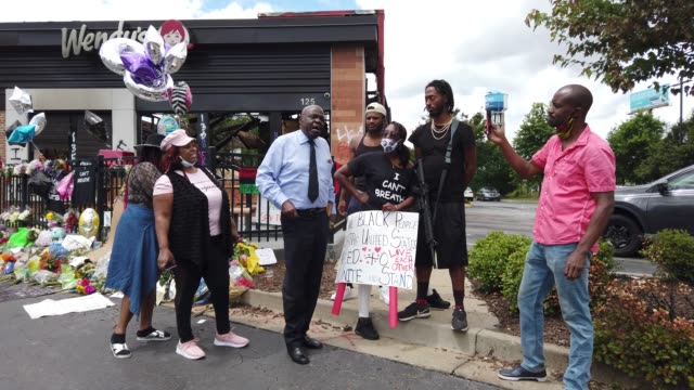 general footage as people visit the wendy's restaurant that was set on fire after rayshard brooks was killed, on june 16, 2020 in atlanta, georgia.... - sobriety test stock videos & royalty-free footage