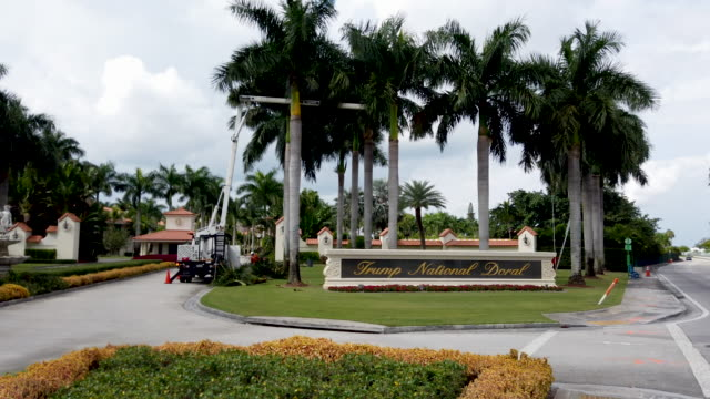 general footage of a sign near an entrance to the trump national doral golf resort owned by us president donald trump's company on october 17 2019 in... - doral stock videos and b-roll footage